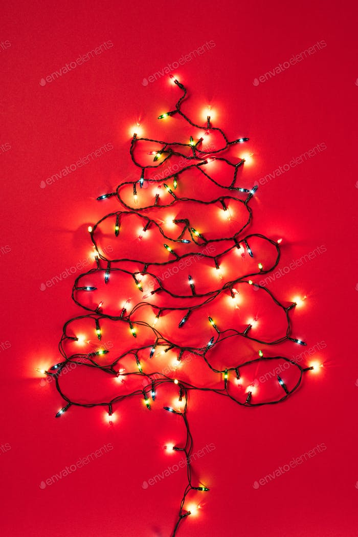 Colourful garlands in the form of christmas tree on red background