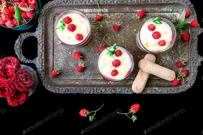 Tiramisu with raspberry in glasses