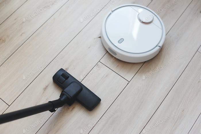 Choice between an old vacuum cleaner and a modern robot vacuum cleaner.