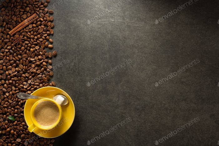 cup of coffee and beans on table