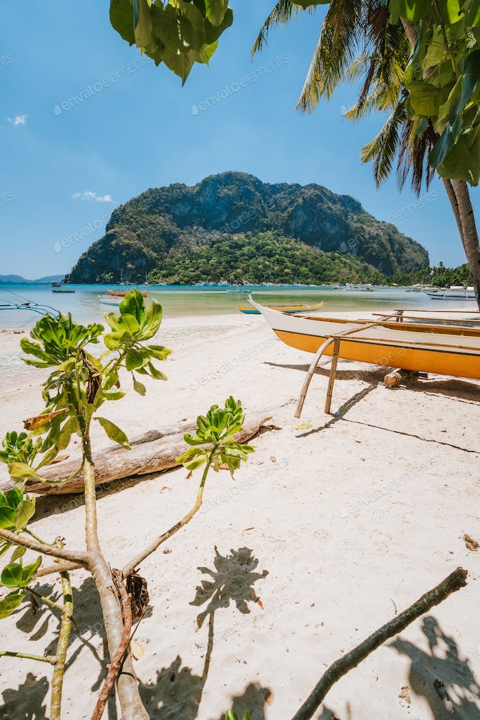 Traditional banca boat on sandy Corong Corong Beach in El Nido, Philippines