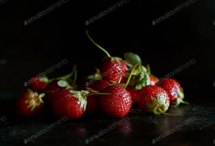 Strawberries in a tray on a dark table