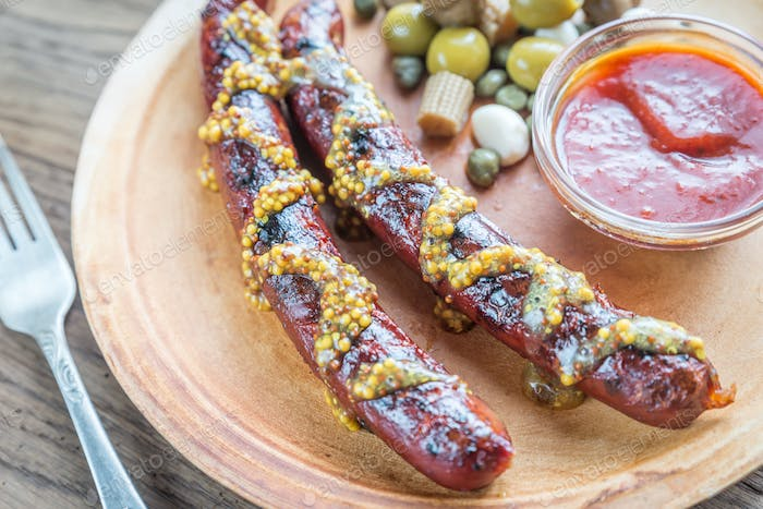 Grilled sausages with marinated vegetables