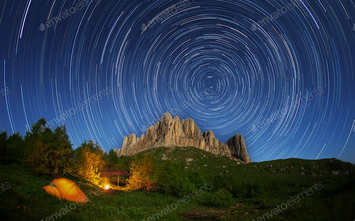 Touristic camp on a background of mountain Big Thach and starry