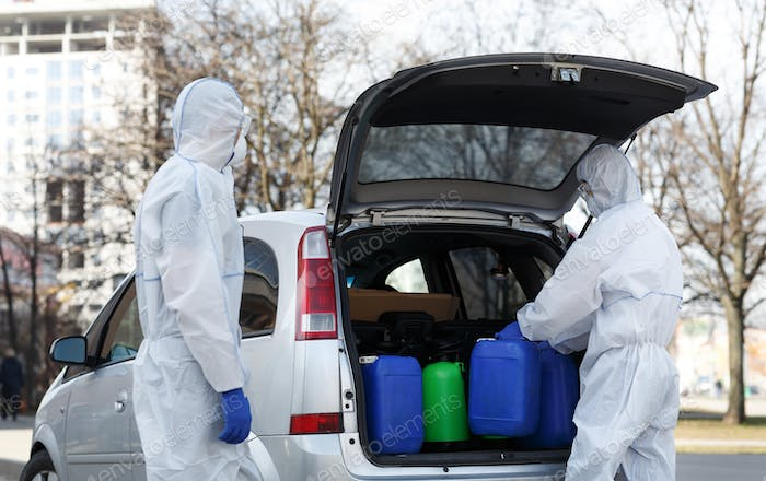 Family in virus protective suits buying disinfectants