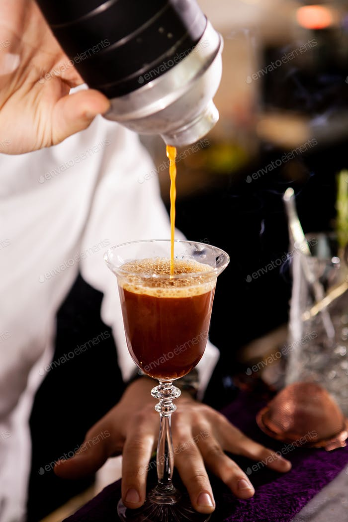 Barman making alcohol coffe drink