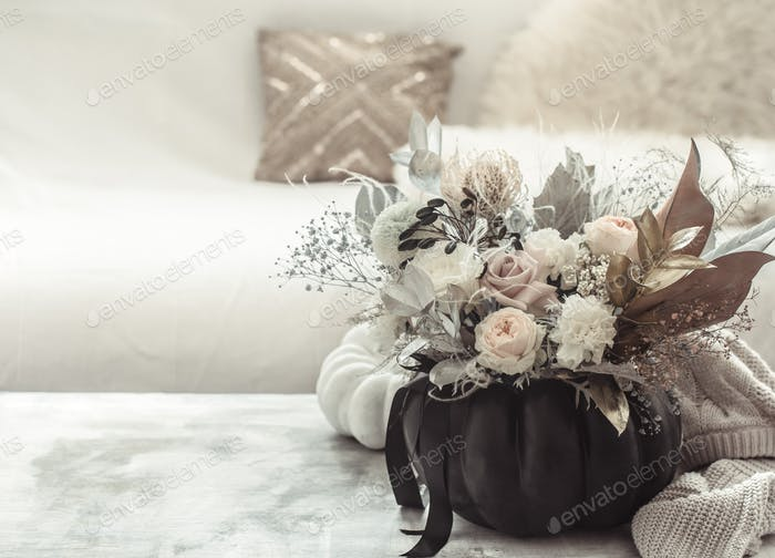 Beautiful composition of flowers in the interior of the room.