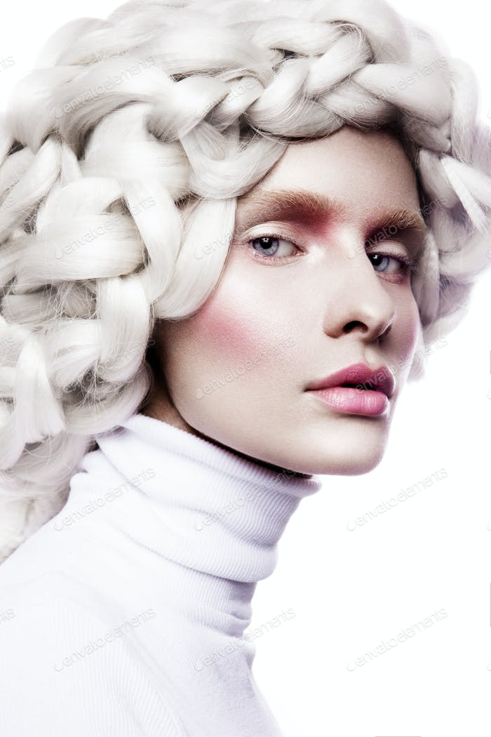 Young woman in creative image with artistic make-up.