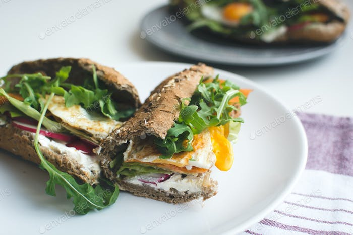 Thumbnail for Wholewheat baguette with fried egg and arugula