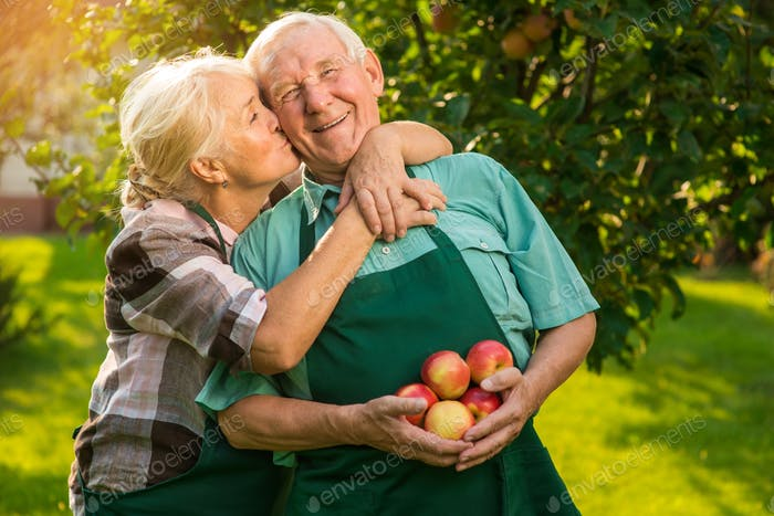 Elderly couple with apples