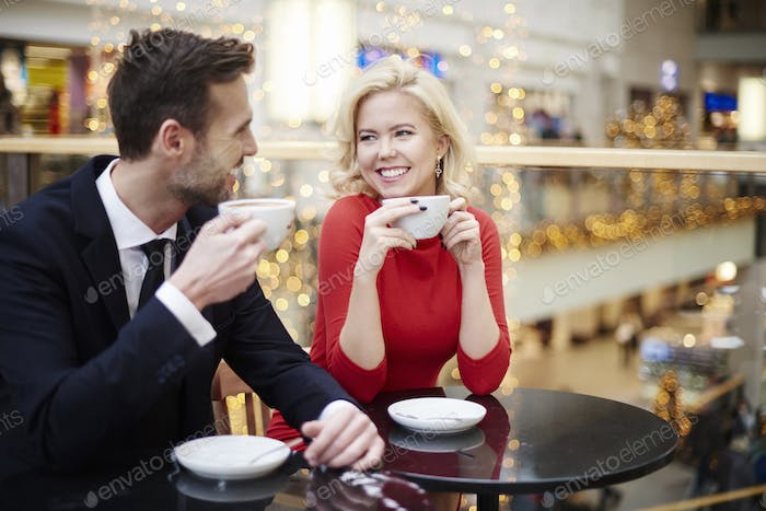 Couple drinking coffee at the shopping centre