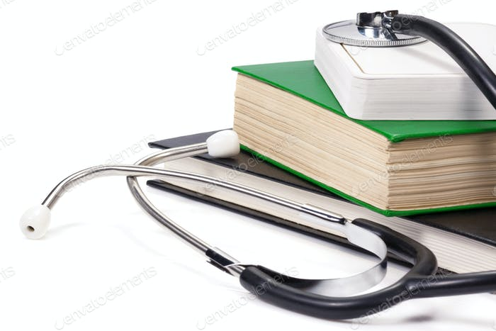 old books and black stethoscope isolated on white