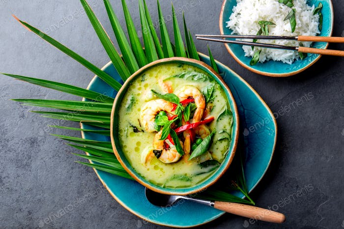 THAI SHRIMPS GREEN CURRY. Thailand tradition green curry soup with shrimps prawns and coconut milk