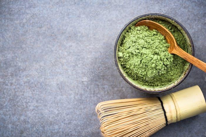Matcha green tea powder and bamboo whisk