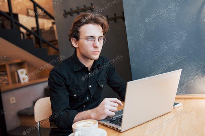 Creative man designer working on his laptop computer