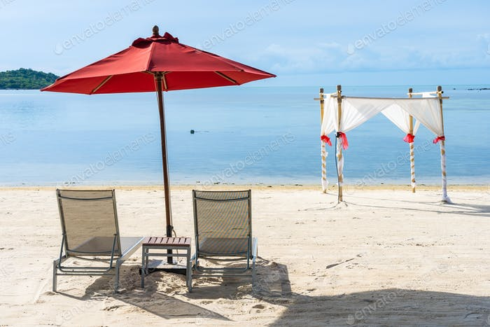 Beautiful outdoor tropical beach sea ocean with umbrella chair a