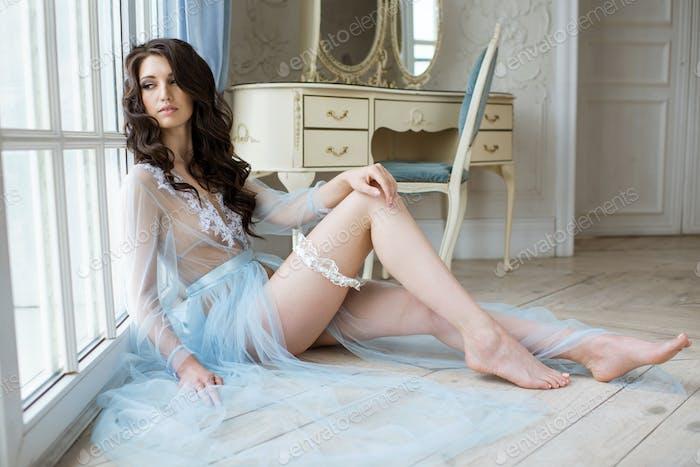 Beautiful sexy lady in elegant blue robe