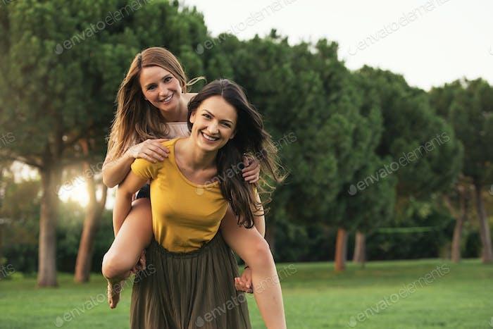 Beautiful women having fun in the park.