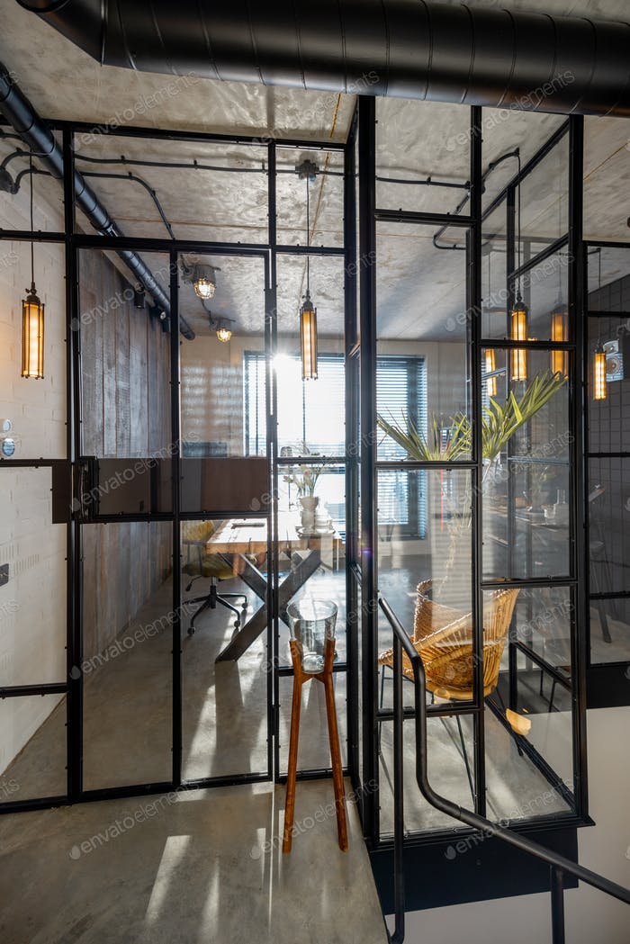 Glass partition to the home office in loft style