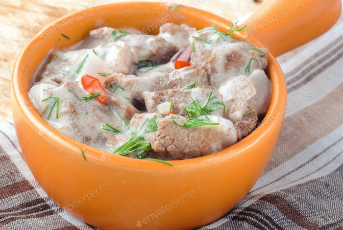 Meat goulash in baked potato sauce.
