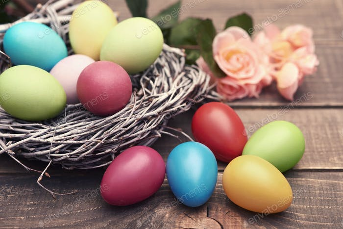 Multi colored eggs on the brown planks