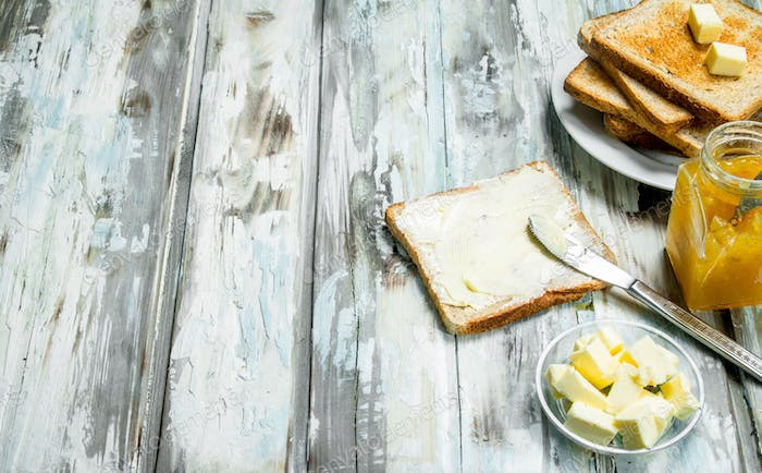 Breakfast. Toasted bread with butter and orange jam .