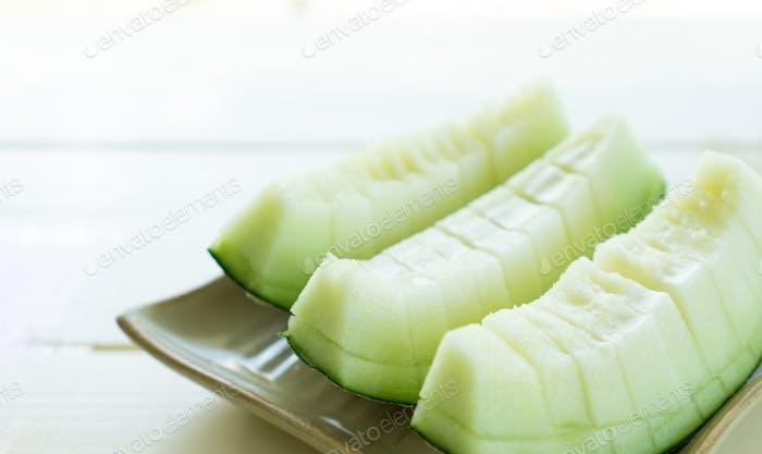 Juicy slice melon on plate