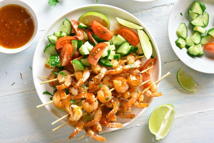 Prawns skewers with sauce