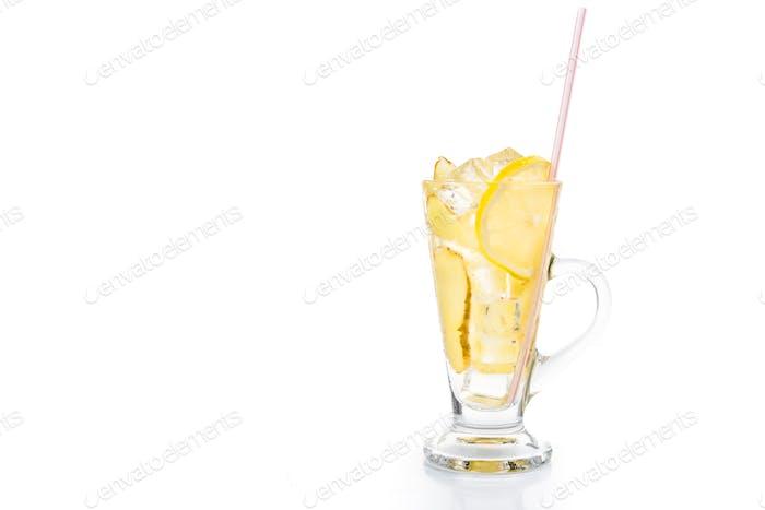Refreshing ice cold ginger lemon tea in transparent glass