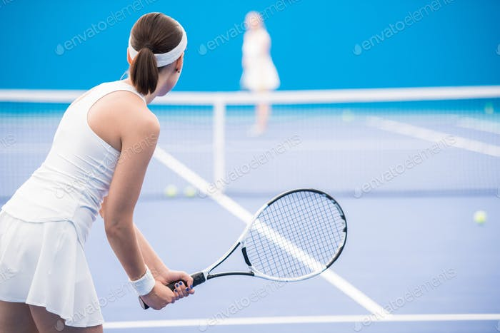 Motivated Woman Playing Tennis