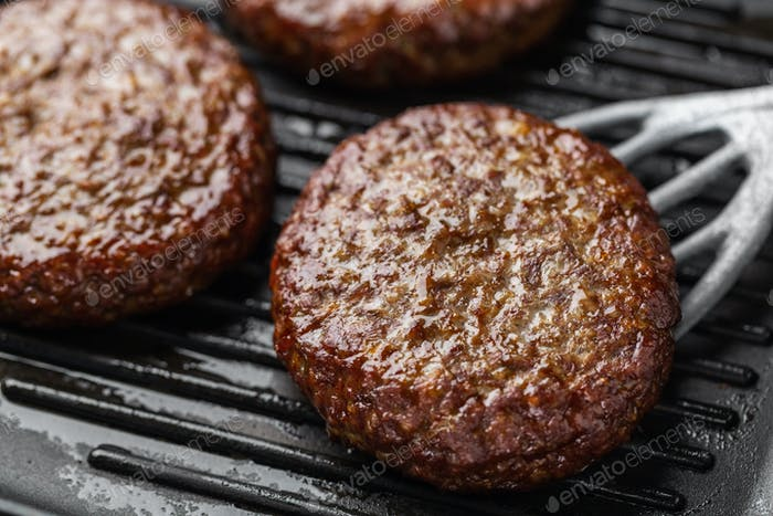 Cooking process of beef patties on pan