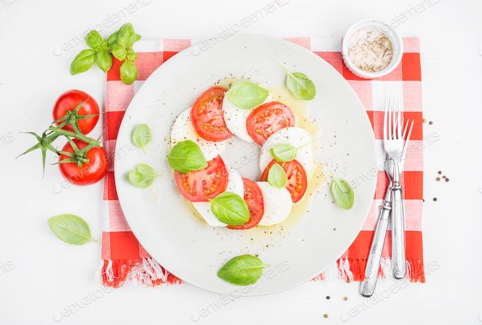 CLassic Italian Caprese salad with tomatoes, mozzarella di Buffala and fresh basil.