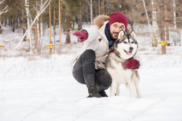 Loving Owner with Dog