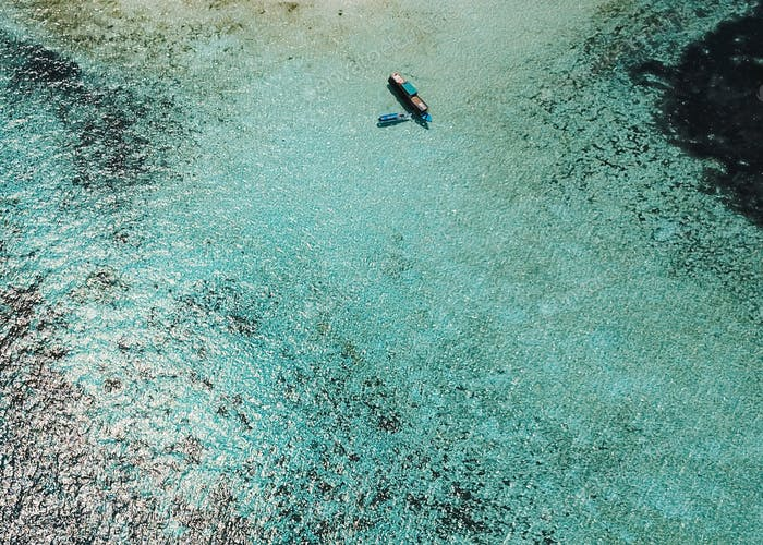 Aerial view of boat on transparent sea