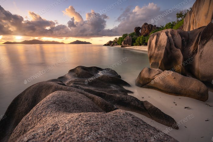 Sunset at exotic Anse Source d'Argent beach, La Digue island, Seychelles