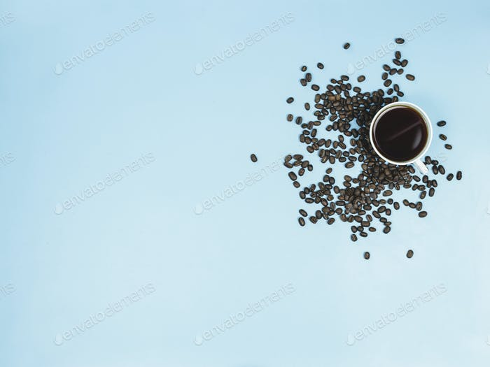 top view black coffee and coffee beans on blue background