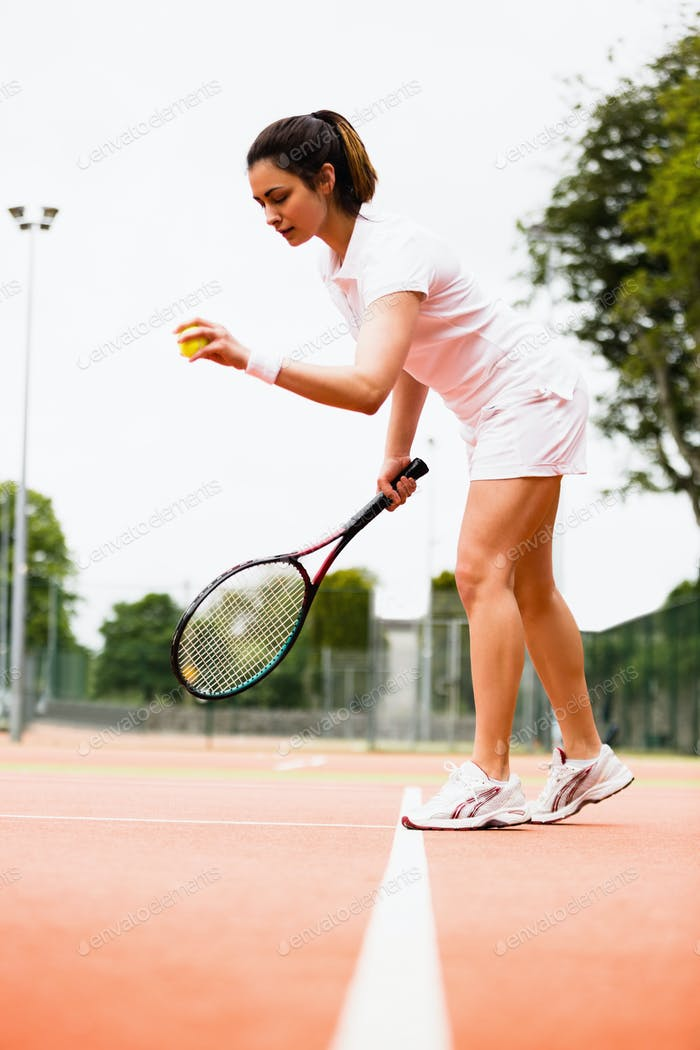 Tennis player playing a match on the court on a sunny day