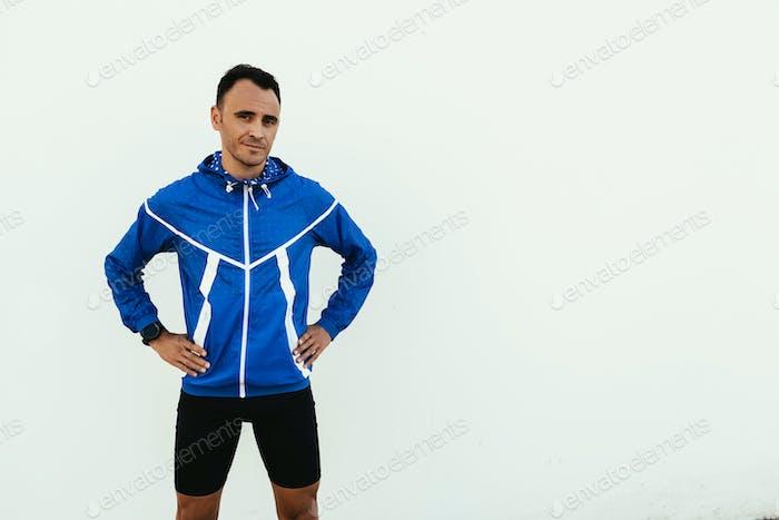 Portrait of handsome man runner in the city.