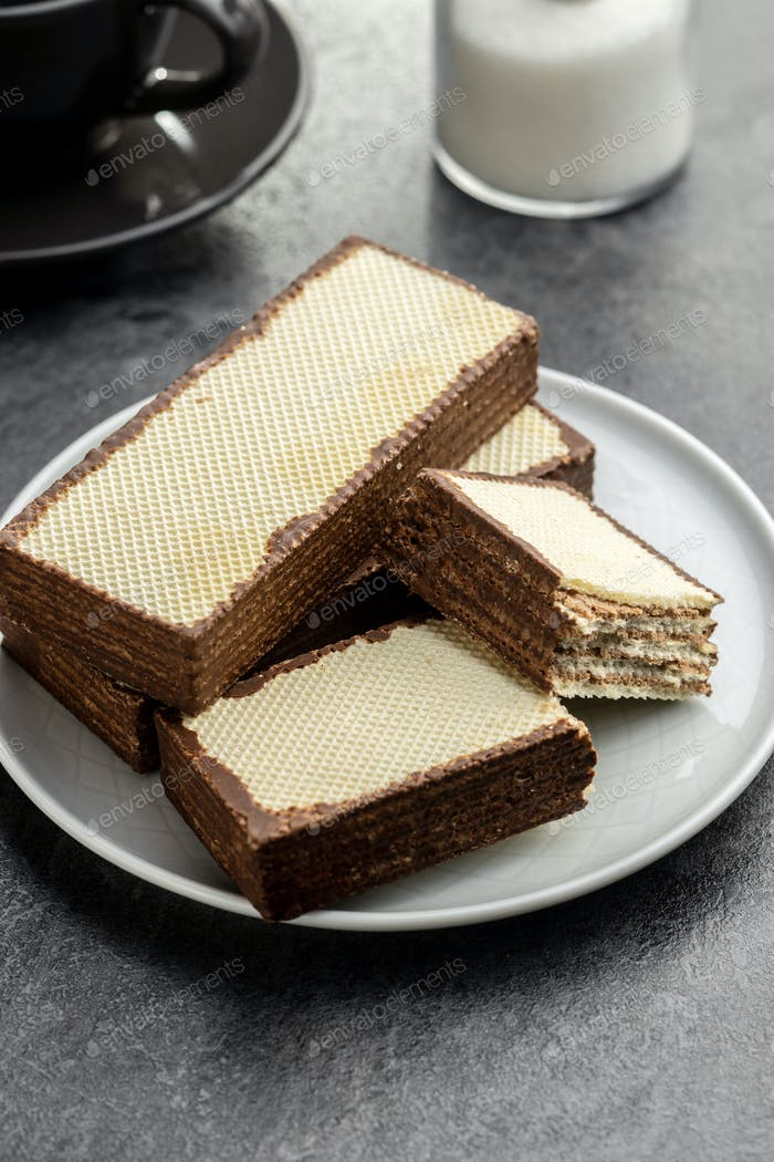 Crispy wafer biscuits filled with chocolate cream.