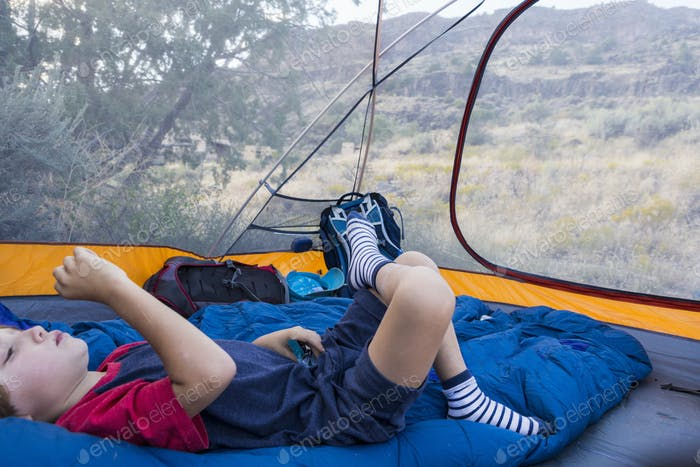 6 year old boy lying down in tent