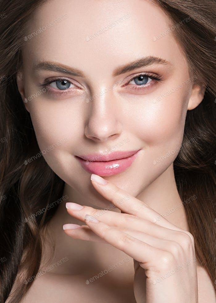 Woman face hand manicure nails touching skin woman beauty portrait