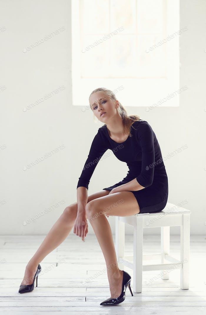 Slim woman in a black short dress.