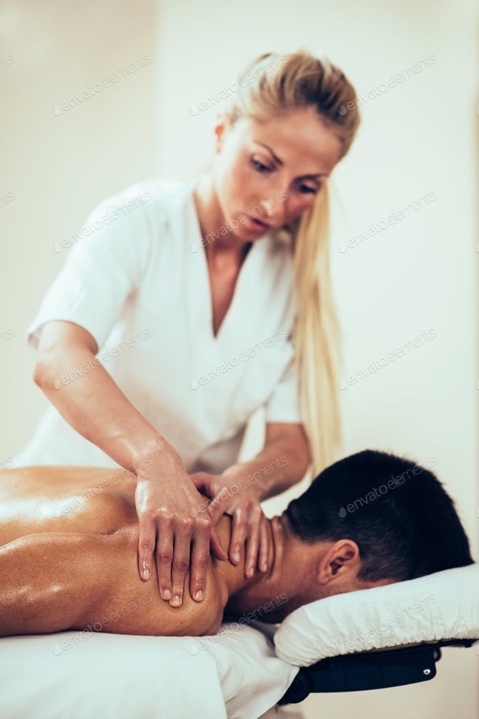 Sports massage. Physical therapist doing massage of shoulders