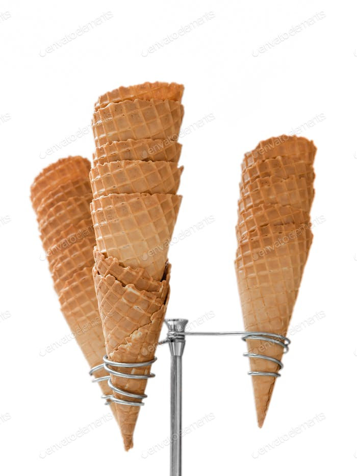 Ice cream waffle cones on dispenser isolated on white background