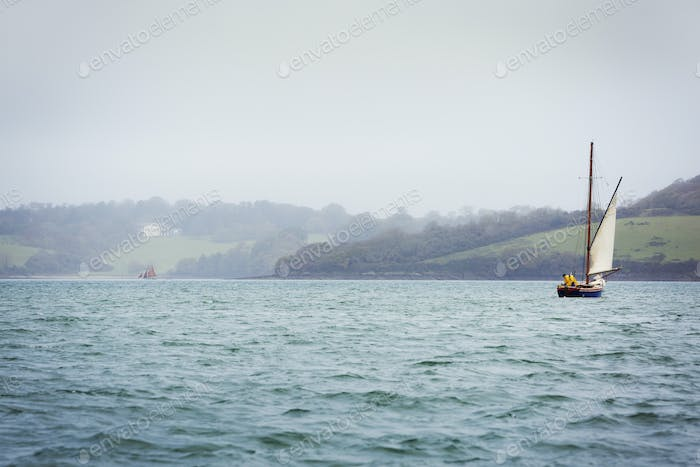 Traditional sailing boat off the coast of the estuary on the River Fal, Falmouth, Cornwall