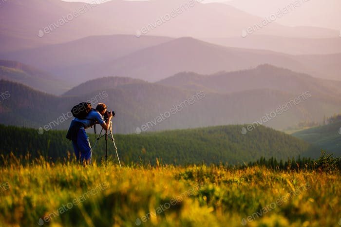Professional photographer in the mountains.