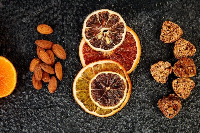 Healthy snacks -  variety oat granola bar,  rice crips, almond,   dried orange