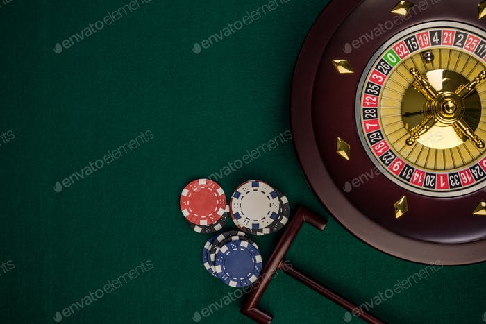 Wooden Roulette Drum on Green Casino Felt Table, Border BAckgrou