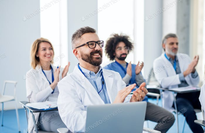 Group of doctors listening to presentation on medical conference