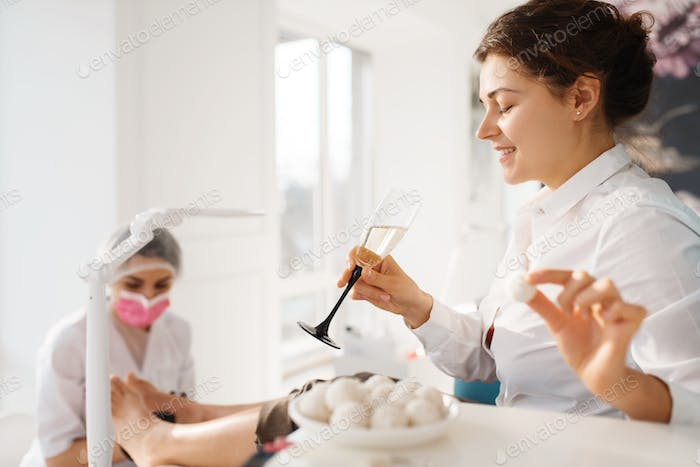 Woman with champagne relax in beauty salon